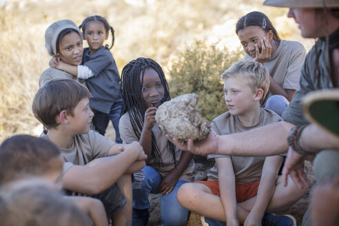 Children at a camp learning from guide - ZEF16092