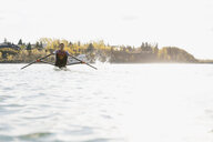 Rower in scull on sunny river - HEROF03337