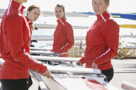 Rowing team carrying scull - HEROF03340