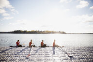Rowing team in scull at waterfront - HEROF03343