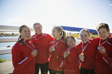 Portrait of rowing team with medals celebrating - HEROF03346