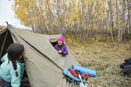 Sisters playing inside tent - HEROF03355