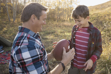 Father and son with football at campsite - HEROF03367