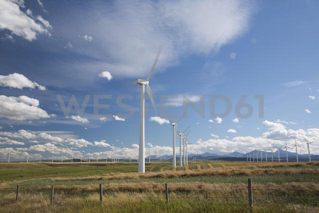 Wind turbines in sunny rural field - HEROF03376 - Hero Images/Westend61