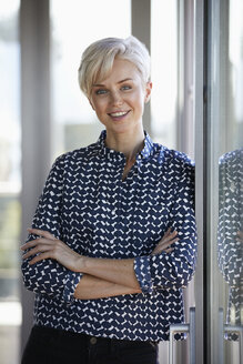 Portrait of smiling businesswoman in office - RBF06948