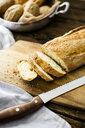Sliced ciabatta on wooden board - GIOF05265