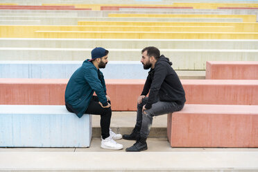 Two friends sitting on benches looking at each other - AFVF02168