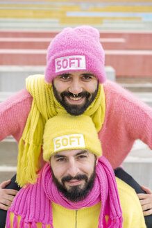 Portrait of smiling gay couple wearing  caps with the word 'soft' - AFVF02171