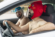 Gay couple in a car wearing animal hats - AFVF02183