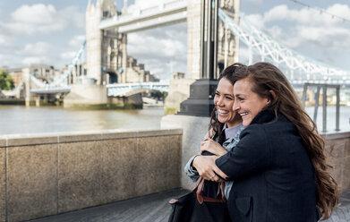 UK, London, two happy women near the Tower Bridge - MGOF03897