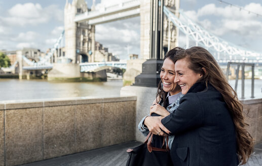 UK, London, two happy women near the Tower Bridge - MGOF03897