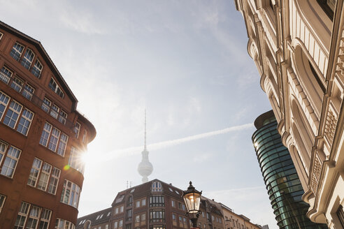 Germany, Berlin, buildings at Rosenthaler Strasse with television tower in the background at morning - GWF05721