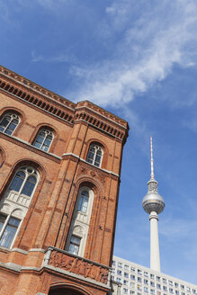 Germany, Berlin, part of facade of Red City Hall with television tower and apartment tower in the background - GWF05730