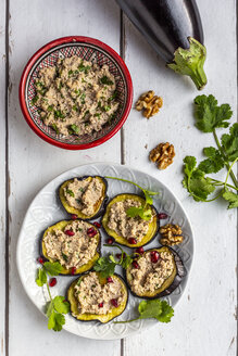 Baked aubergine slices spread with walnut creme garnished with pomegranate seeds - SARF04032