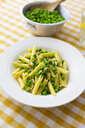 Penne with peas and pine nuts on plate - GIOF05270