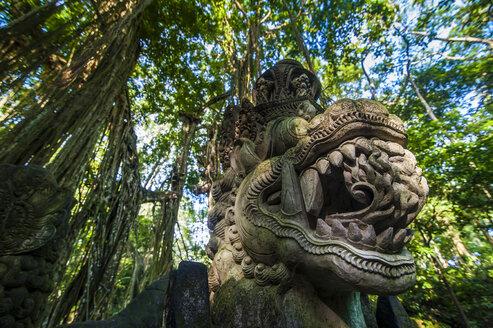 Indonesia, Bali, Ubud Monkey Forest, Stone statue of dragon - RUNF00571