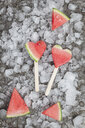 Watermelon heart ice lollies on crashed ice - GWF05742