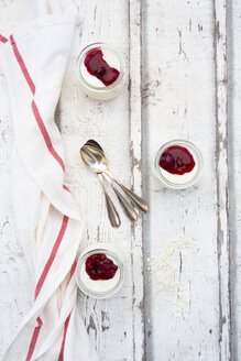 Three glasses of rice pudding with berry compote - LVF07624