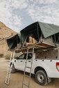 Namibia, woman camping near Spitzkoppe - LHPF00353