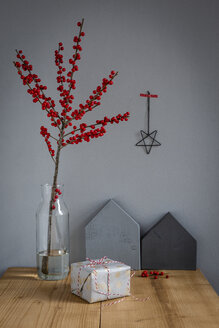 Wrapped present, decoration and   twig of holly in vase - OJF00331