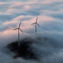 Aerial of wind turbine amidst the clouds. - INGF11466