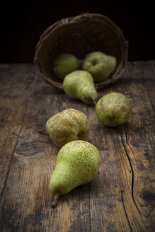 Organic pears 'Conference' on dark wood - LVF07640