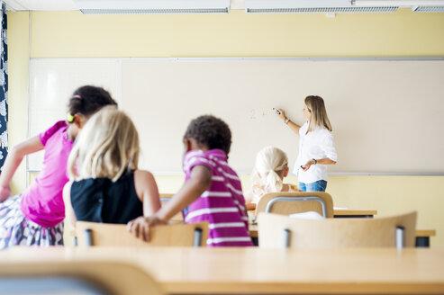 Teacher and children in math class - ASTF00027