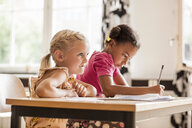 Girls taking notes in classroom - ASTF00072