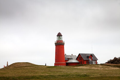 A lighthouse in a field on a dull day - INGF11728
