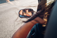 Reflection of a woman in a car mirror - INGF11821