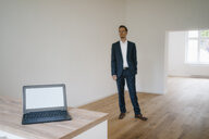 Businessman in looking at newly refurbished home - KNSF05461