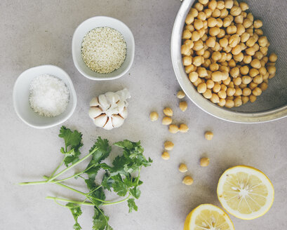 Ingredients for peas hummus, chickpeas, lemon, coriander, garlic, sesame and salt - MBEF01460