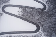 Austria, Wienerwald, winding road in snow-covered landscape, aerial view - HMEF00170