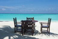 Maledives, Ari Atoll, Nalaguraidhoo, Sun Island Resort, chairs and table of - RUNF00716
