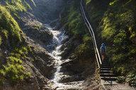 Germany, Bavaria, Werdenfelser Land, female hiker ascending stairs - SIEF08261