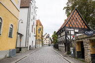 Sweden, Gotland County, Visby, Old town, Cobblestone street - RUNF00757