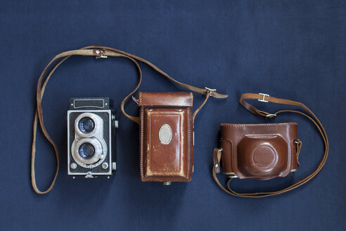 Directly above shot of antique cameras on blue table - ASTF00447