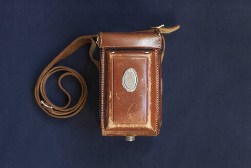 Directly above shot of vintage camera case on blue table - ASTF00450