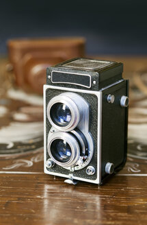 Twin-lens reflex camera on wooden table - ASTF00453