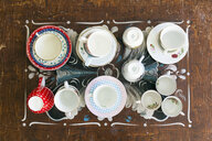 Top view of various tea cups and saucers on wooden table - ASTF00456