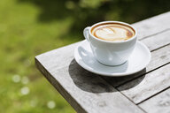 Close-up of cappuccino on wooden table - ASTF00693