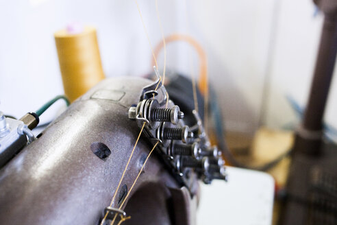Close-up of sewing machine at jeans factory - ASTF00738