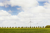 Wind turbines on field against cloudy sky - ASTF00822