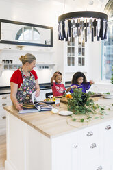 Mother and children cooking food in kitchen - ASTF00945