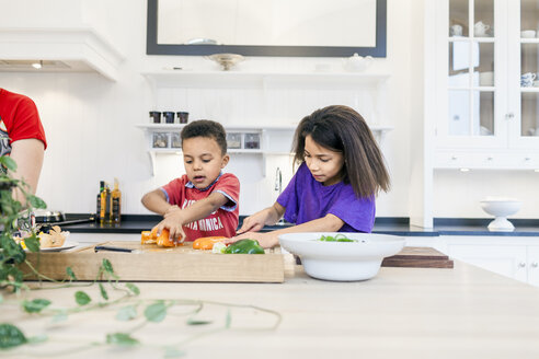 Mother with children cooking together in kitchen - ASTF00963