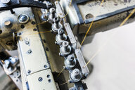 Close-up of sewing machine part in jeans factory - ASTF00981