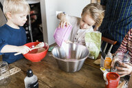 Children baking breads at home - ASTF01257