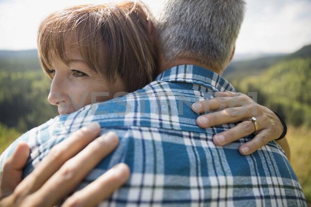Affectionate mature couple hugging - HEROF03616