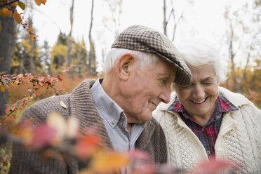Affectionate senior couple in autumn woods - HEROF03763