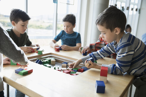 Boys playing with wood blocks in science center - HEROF03847